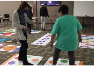 occupational therapists standing on sensory mat